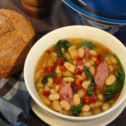 Bowl of Bean, spinach and sausage soup with California Sun Dried Tomatoes