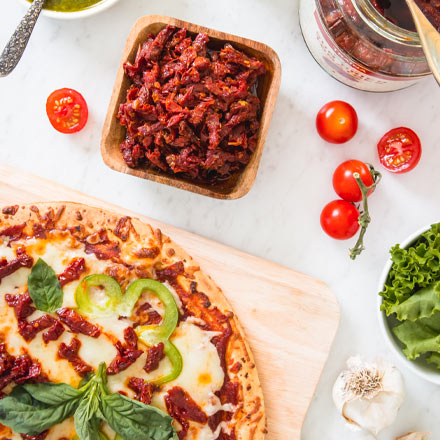 Pizza topped with California Sun Dried Tomatoes